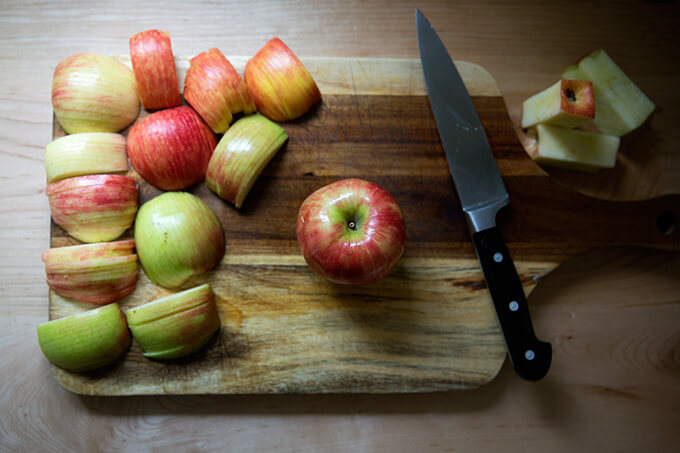 An apple on a cutting board.