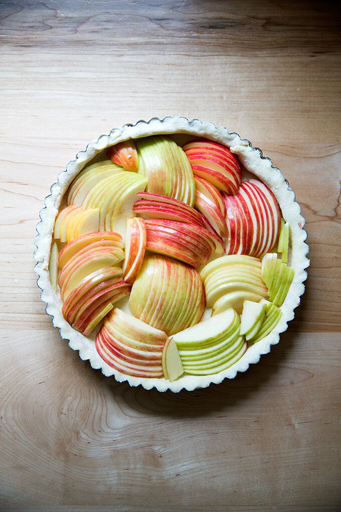 Unbaked French apple tart filled with sliced apples.