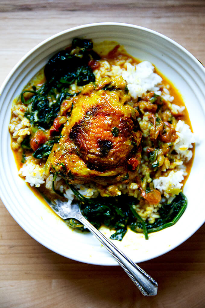 A bowl of one-pot Thai chicken curry with spinach and rice