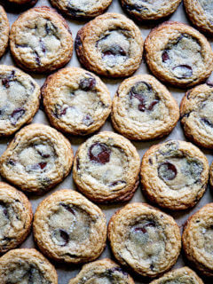 Gluten-free chocolate chip cookies on a sheet pan.