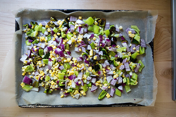 Chopped vegetables on a sheet pan.