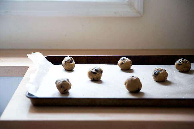Gluten-free cookie dough balls on a sheet pan.