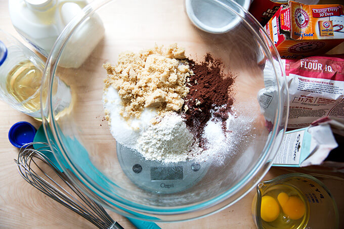 A large bowl filled with the dry ingredients to make one-bowl chocolate cupcakes.