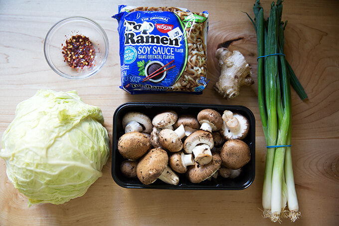 An overhead shot of the ingredients to make one-pot ginger-scallion ramen noodles.