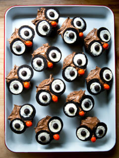 A tray of cupcakes decorated as owls.