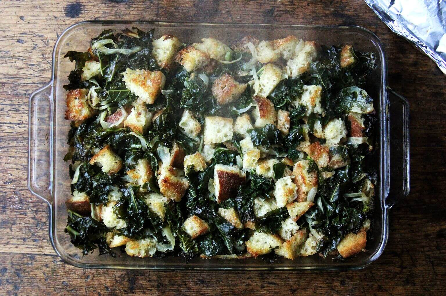 A 9x13-inch pan filled with just-baked stuffing, baked directly from the freezer.