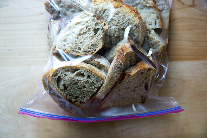 A ziplock bag filled with sliced whole wheat sourdough bread.
