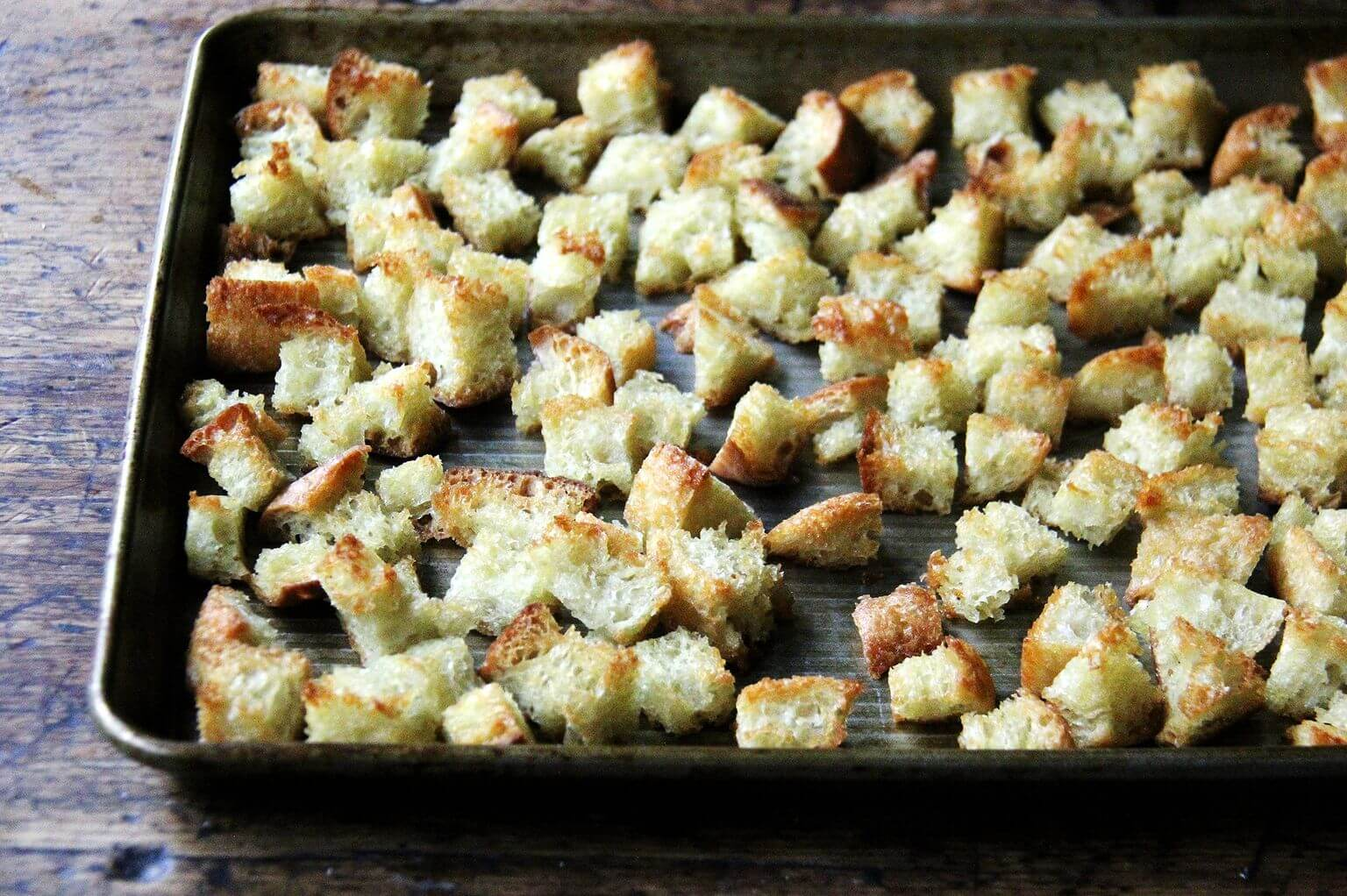 a sheet pan of cubed toasted peasant bread