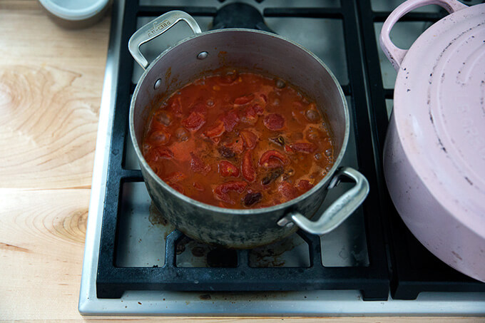 A saucepan filled with vodka sauce simmering.