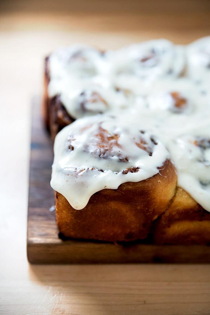 A brioche cinnamon bun, frosted.
