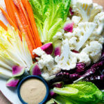 A platter of crudités with spicy cashew dip.