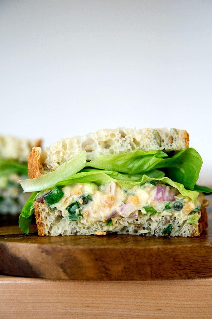 "A halved, no-tuna ""tuna"" salad sandwich made with chickpeas."