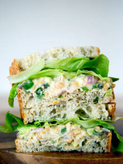 "No-tuna ""tuna"" salad sandwich, cut and stacked on top of one another."