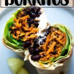 A halved sweet potato and black bean burrito.