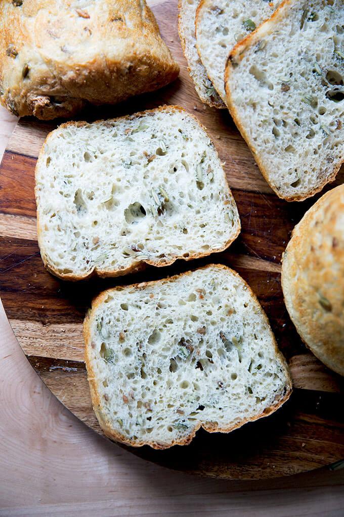 Sliced three-seed bread on a board.