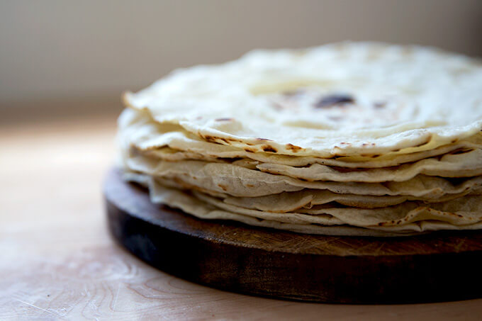 A stack of homemade flour tortillas.