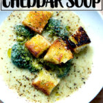 A bowl of broccoli-cheddar soup with olive oil toasted croutons.