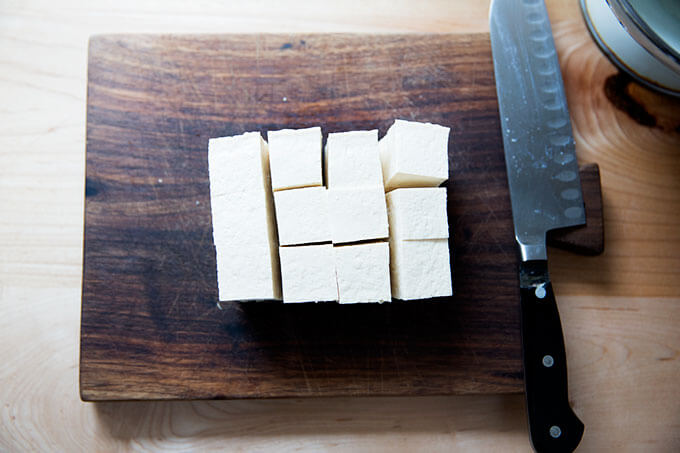 A block of tofu cut into cubes.
