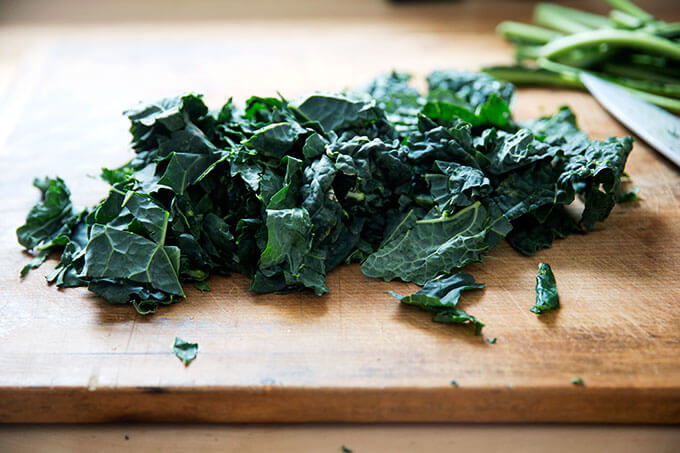 Kale, chopped, on a cutting board.