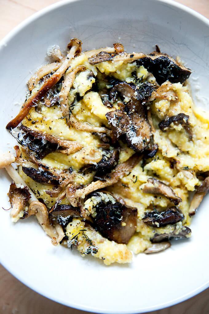An up close shot of a bowl of roasted mushroom polenta bake.