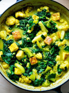 An overhead shot of a veggie and tofu curry in a skillet.