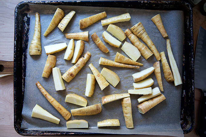 A sheet pan with un-roasted parsnips.