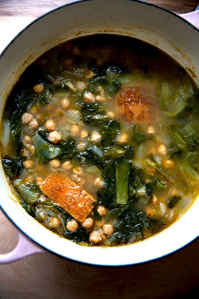 A large pot of escarole and chickpea soup.