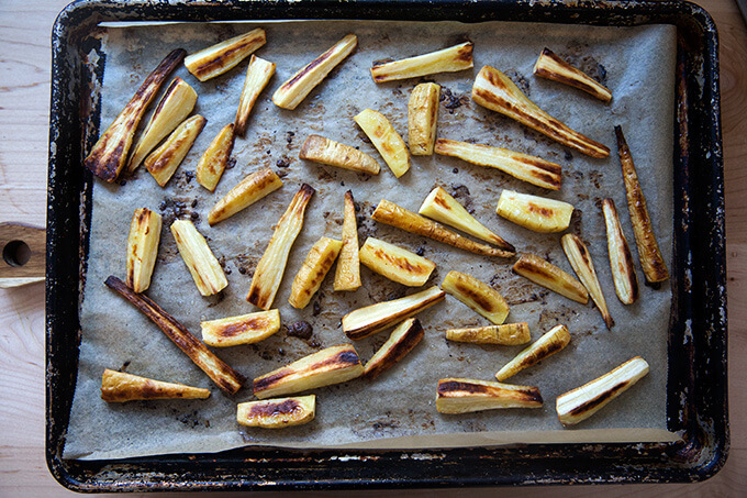 A sheet pan of roasted parsnips.