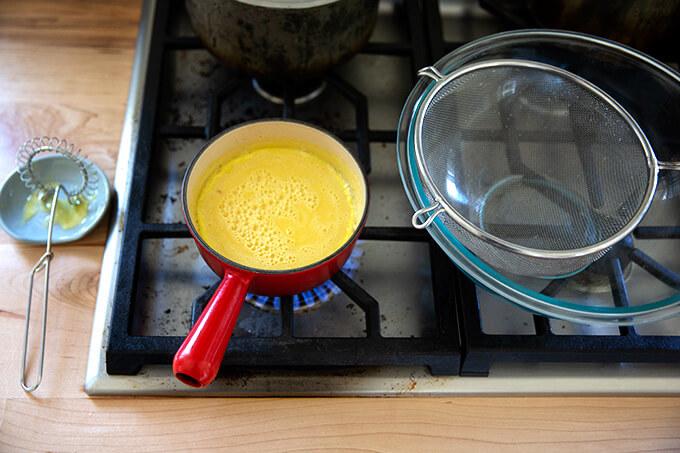 Mustard sauce simmering stovetop.