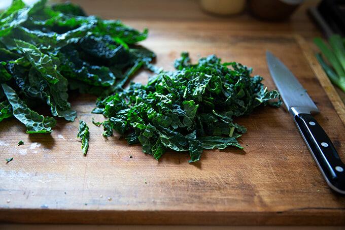 Chopped kale on a board.
