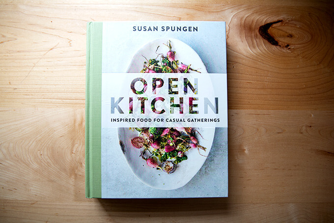 A cookbook, Open Kitchen, on the counter.