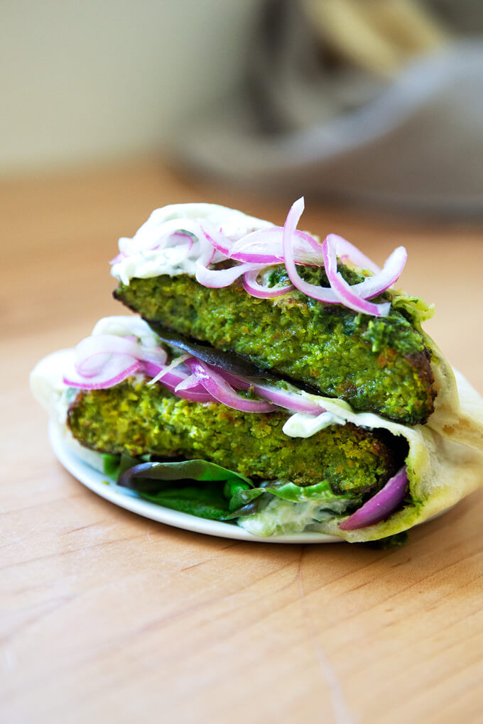 Falafel burgers on a plate.