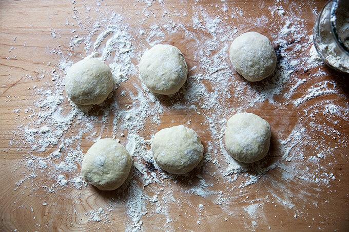 Six rounds of pita bread dough.
