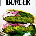 Halved falafel burger on a plate.