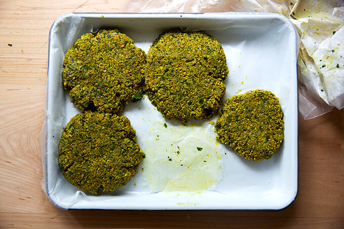 Frozen falafel burgers on a tray.
