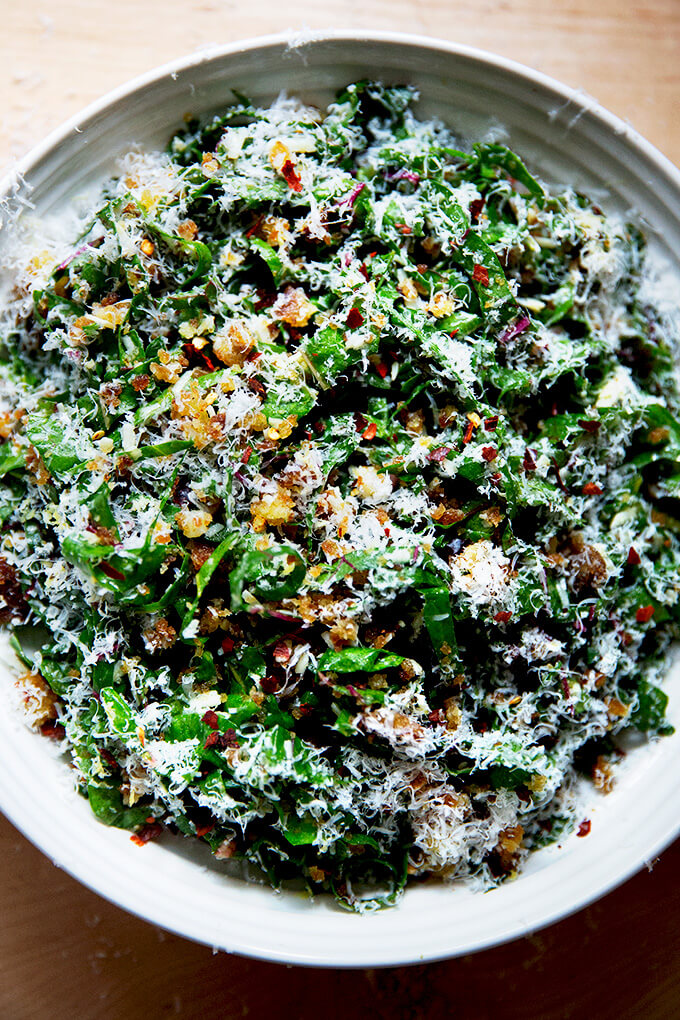 A plate of Swiss chard salad with parmesan and bread crumbs.