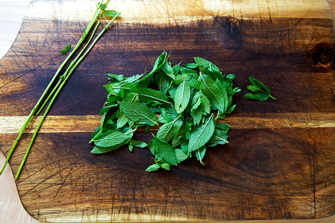 Mint leaves on a board.