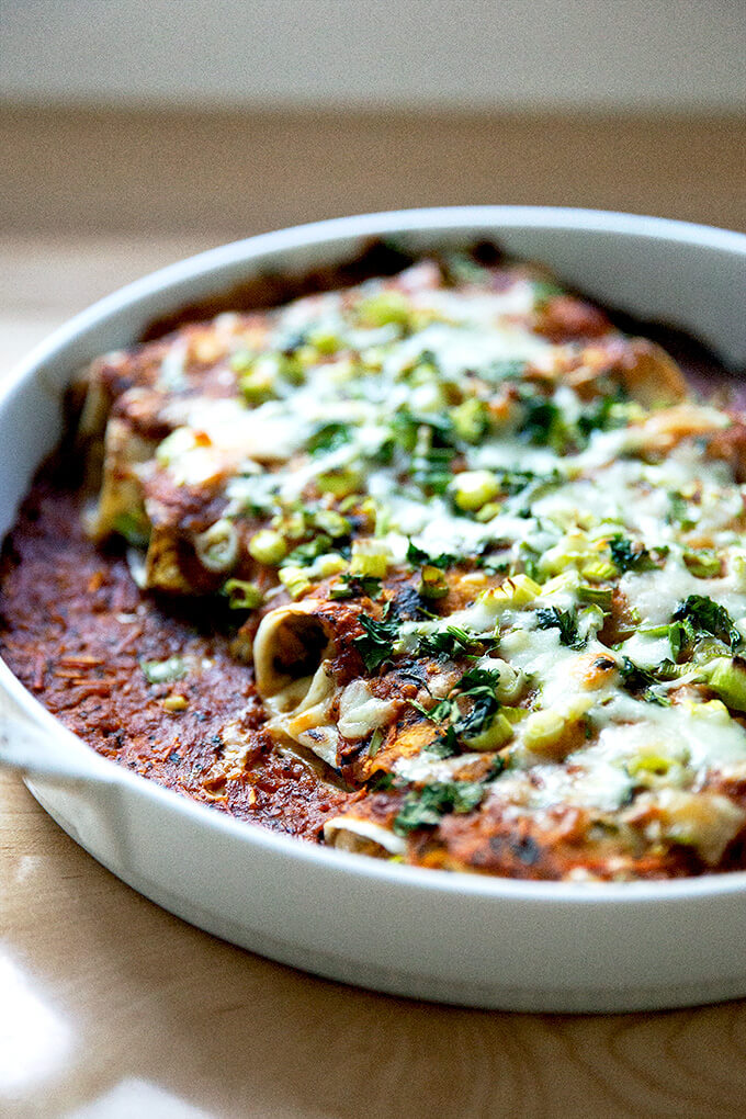 A just-baked dish of chicken enchiladas.
