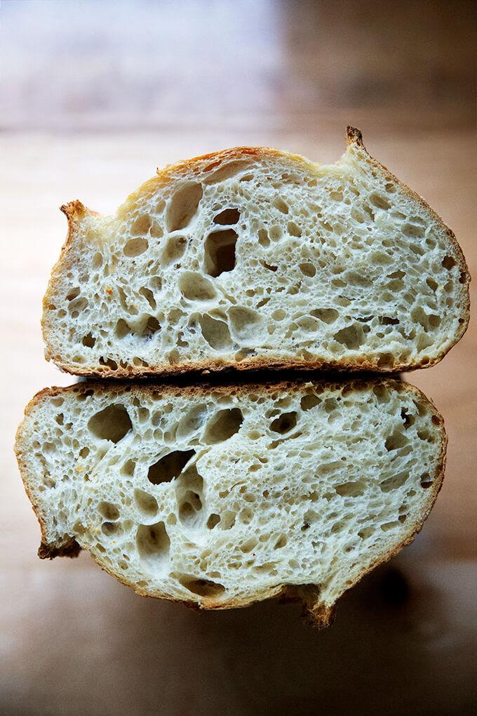 A halved loaf of sourdough bread.