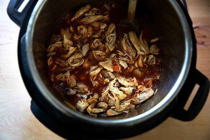 An Instant Pot filled with just-cooked chicken tinga.