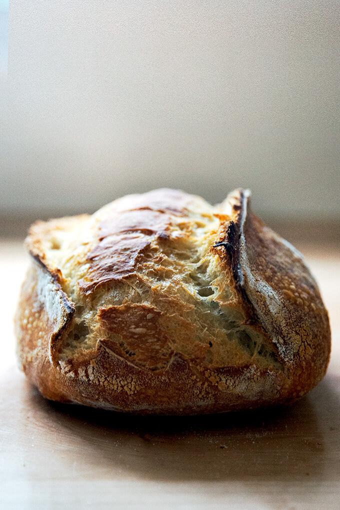 A freshly baked loaf of sourdough bread.