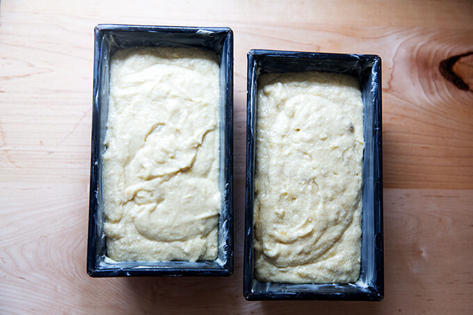 Two loaf pans with banana bread batter inside.