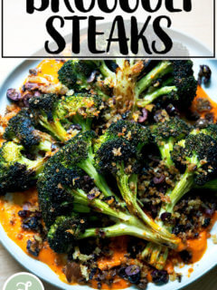 A plate of roasted broccoli steaks topped with olive bread crumbs.