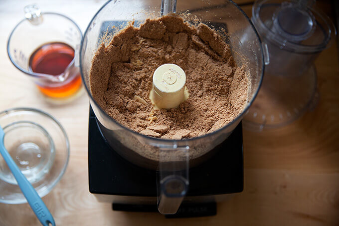 Dry ingredients for rum balls pulsed together in a food processor.