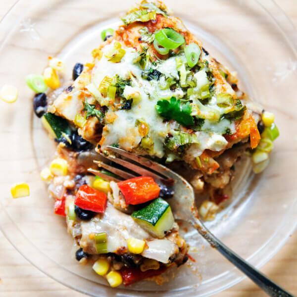 A piece of vegetarian tortilla casserole on a plate.