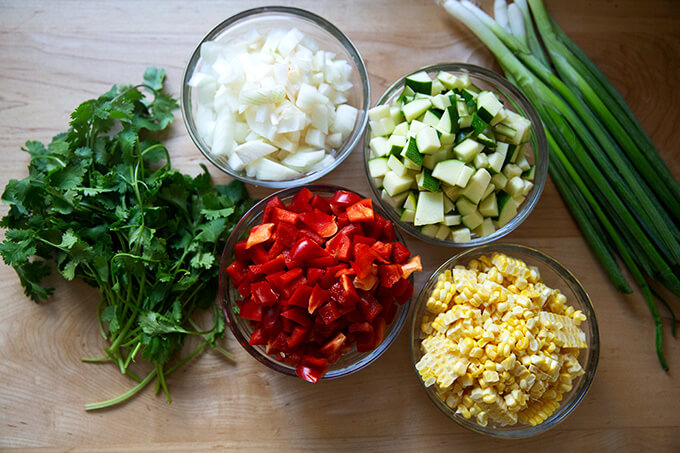 The ingredients to make sautéed summer vegetable tortilla casserole.