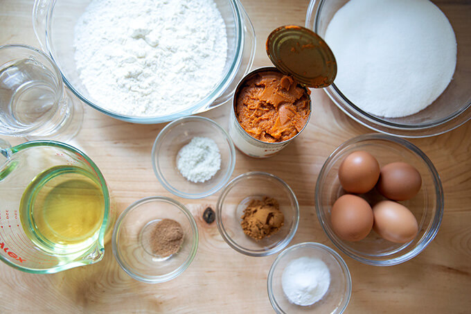 Ingredients to make one-bowl pumpkin bread on a countertop.
