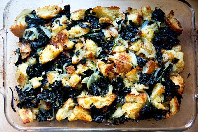 A 9x13-inch pan filled with kale and caramelized onion stuffing.