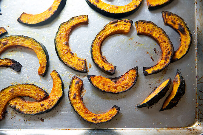 Roasted kabocha squash on a sheet pan.