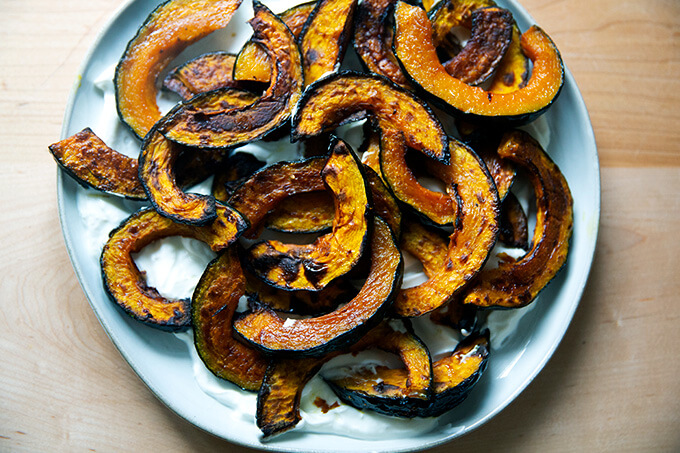 Roasted Kabocha squash atop lemony yogurt sauce.